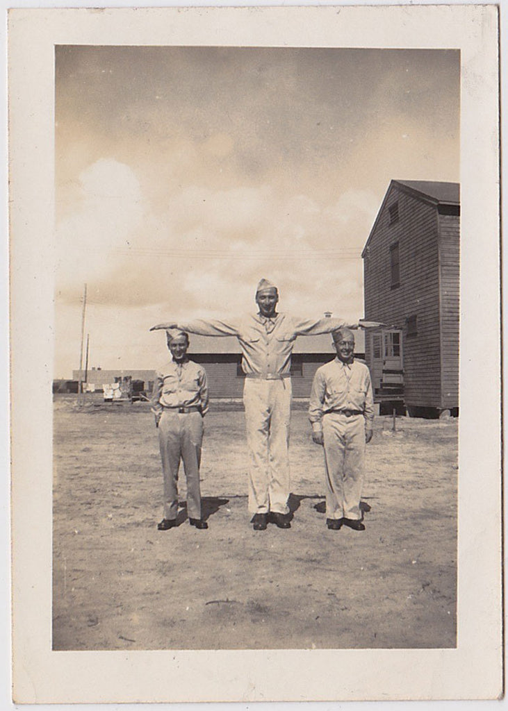 Tall and two short soldiers in a row vintage snapshot