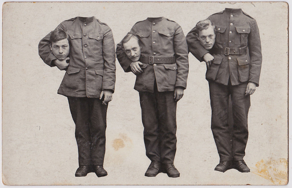 3 decapitated soldiers hold their heads in the crook of their arms