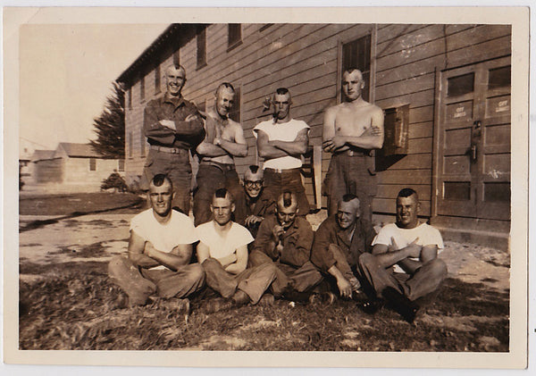 Ten soldiers outside their barracks proudly displaying their Mohawks Vintage snapshot