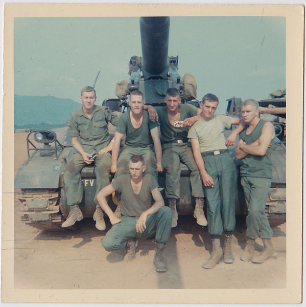 Color snapshot of a six-man tank crew in front of their tank.