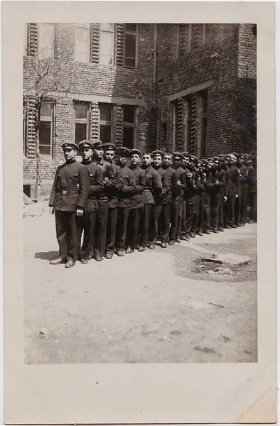 Vintage Real Photo Postcard: A rather undisciplined row of soldiers