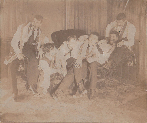 Reclining on a Divan: Men in Rows vintage cabinet card