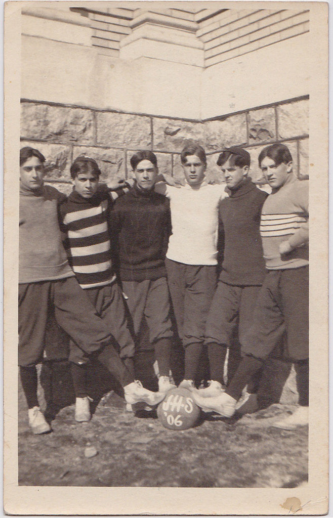 Vintage sepia Real Photo Postcard of six serious young men place their feet on a basketball. JHS '06