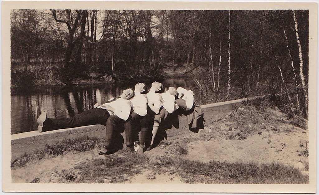 Reclining on a Wall: Affectionate Men in Rows