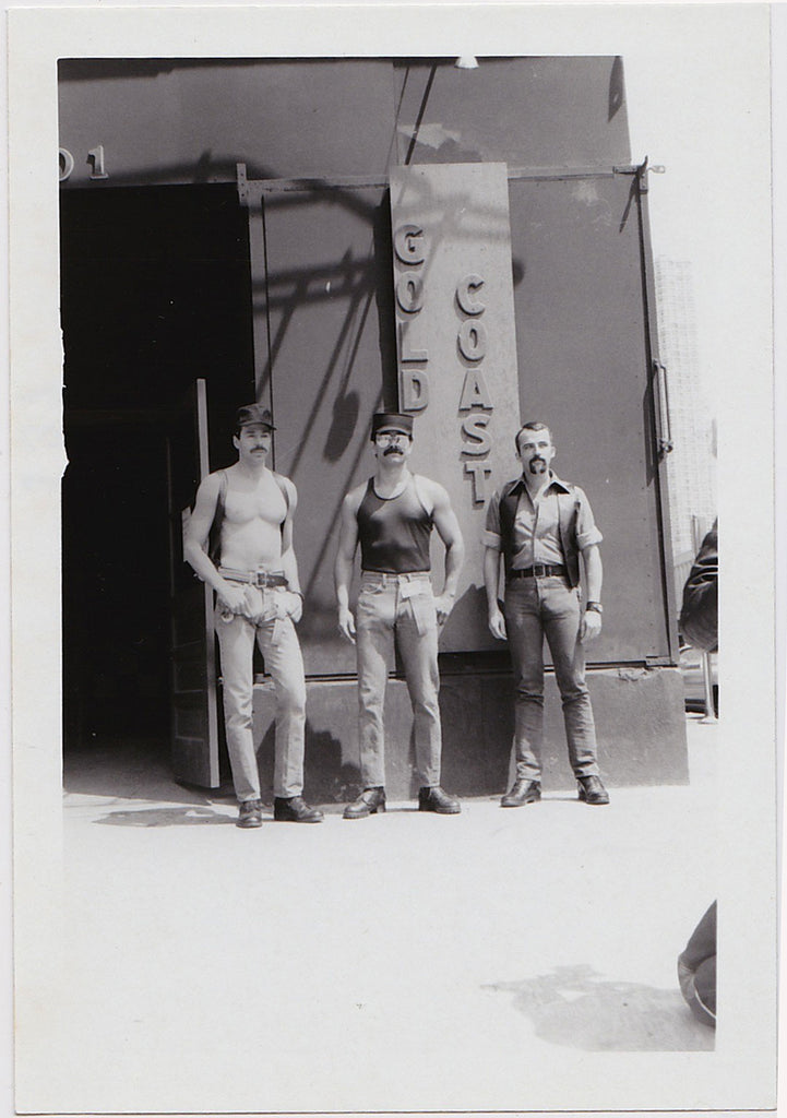 Three macho men stand outside the Gold Coast bar in Chicago, vintage photo
