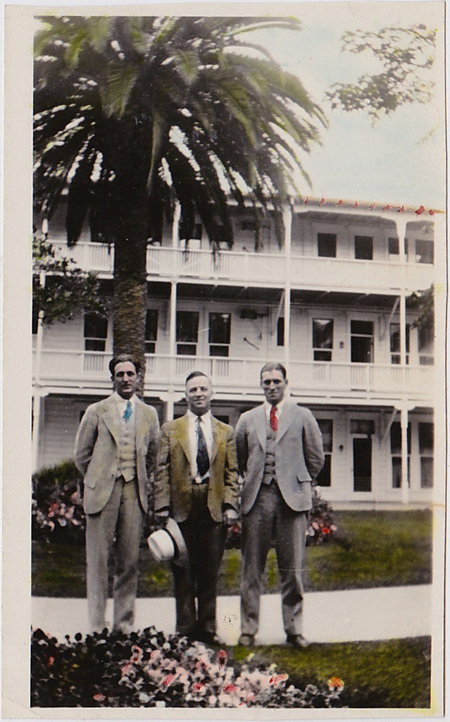 Three men standing in the gardens at the Coronado Hotel, San Diego vintage hand-colored snapshot
