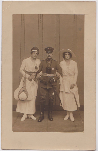 "Officer and Two ""Ladies"" vintage real photo postcard"