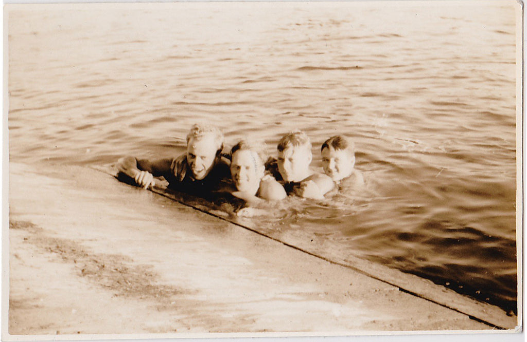 Four Men in the Water vintage snapshot