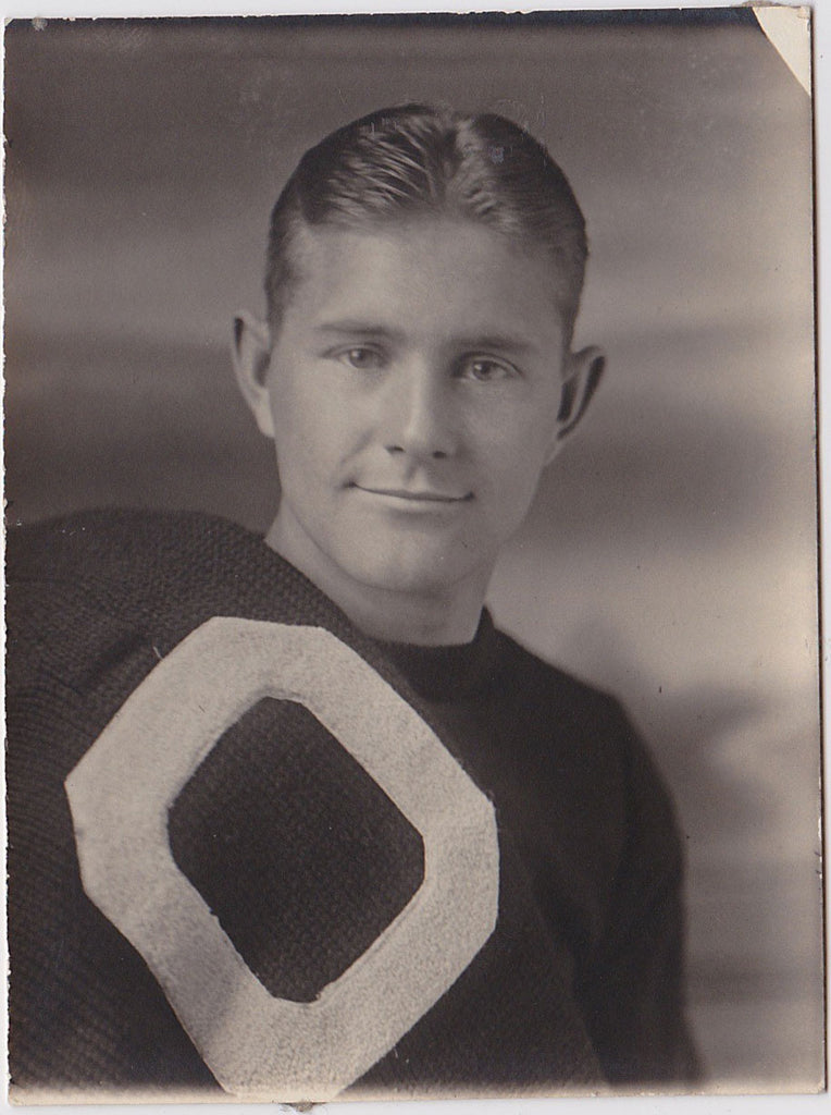 Athlete holding letter sweater vintage photo