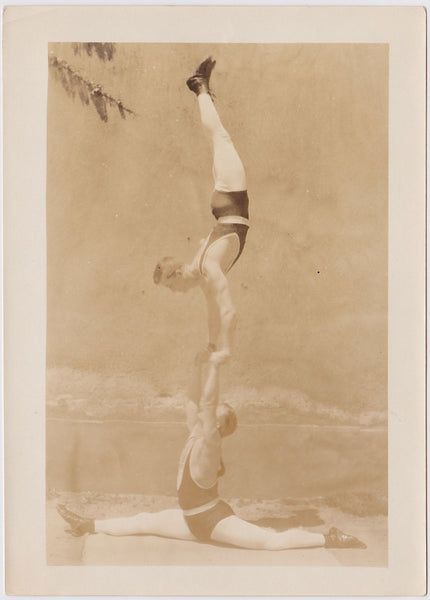Vintage Sepia Photo: Two Acrobats Practicing