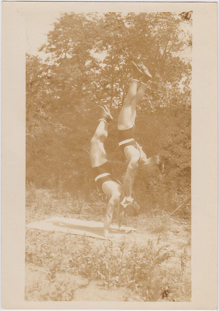Vintage Sepia Photo: Two Acrobats Balancing