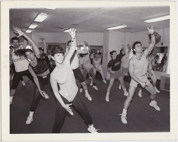 Group of good looking men and women in an aerobics class vintage photo