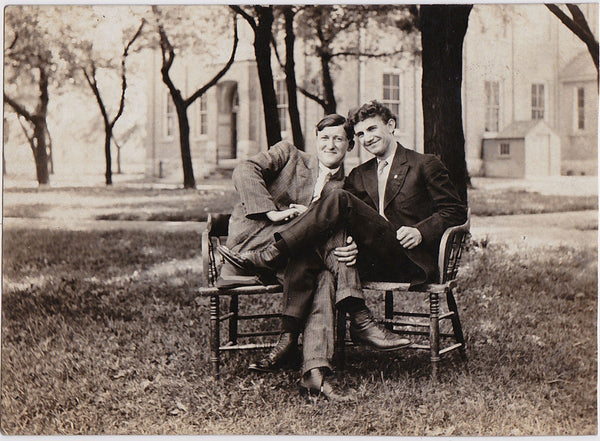 This couple of men entangle their legs and arms. Vintage real photo postcard c. 1920.