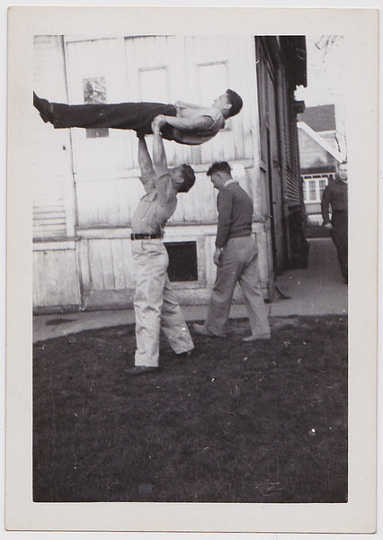 Gymnasts practice in their back yard.    Vintage photo gloss finish, undated c. 1950s.