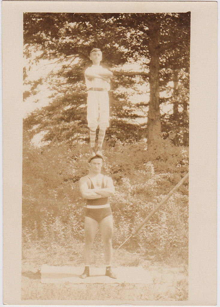 Vintage Photo: Boy Standing on Acrobat's Head