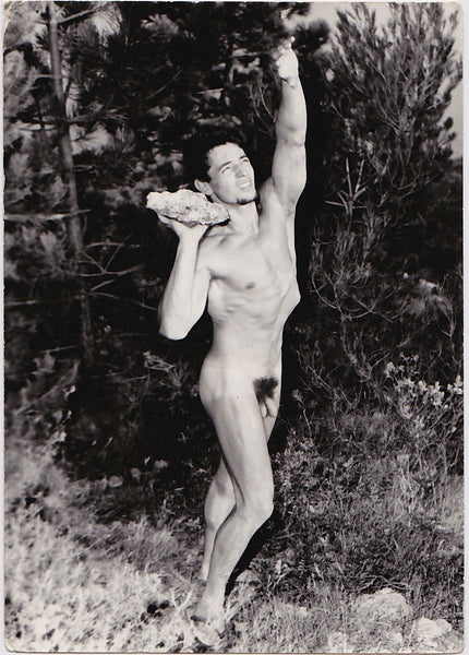 Vintage photo of an unidentified male nude lifting a rock, by Jean Ferrero, Nice, France.