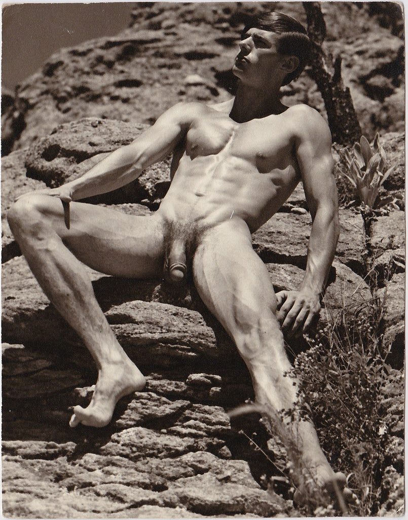 Vintage photo by Don Whitman / Western Photography Guild of an unidentified young man in a rocky outdoor setting.