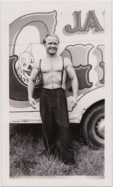 A handsome, smiling blond circus stud vintage physique photo