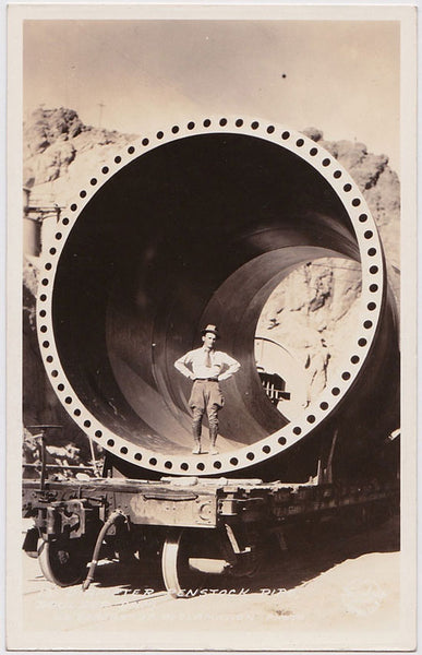 "Stunning image of a man wearing jodhpurs standing inside a section of a 13ft diameter ""Penstock Pipe"" on the construction site of the Boulder Dam (later Hoover Dam)."