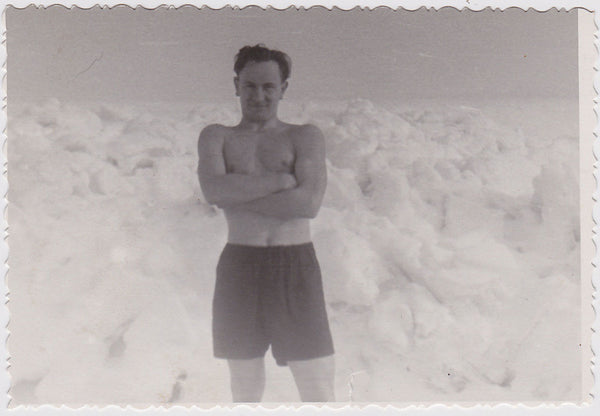 Vintage black and white photo Man Standing in his underwear in Arctic landscape