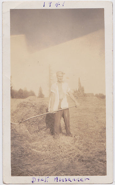 "Vintage snapshot ""Dick Alexander"" stands with his white shirt open, sleeves rolled up, and pitchfork in hand"