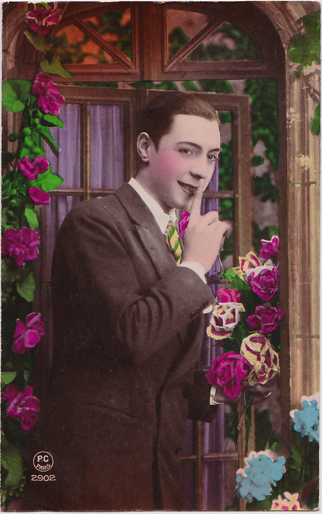 Vintage French Postcard: Man with a Secret