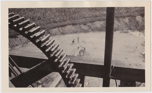 Giant Gear, Tiny People vintage industrial landscape photo