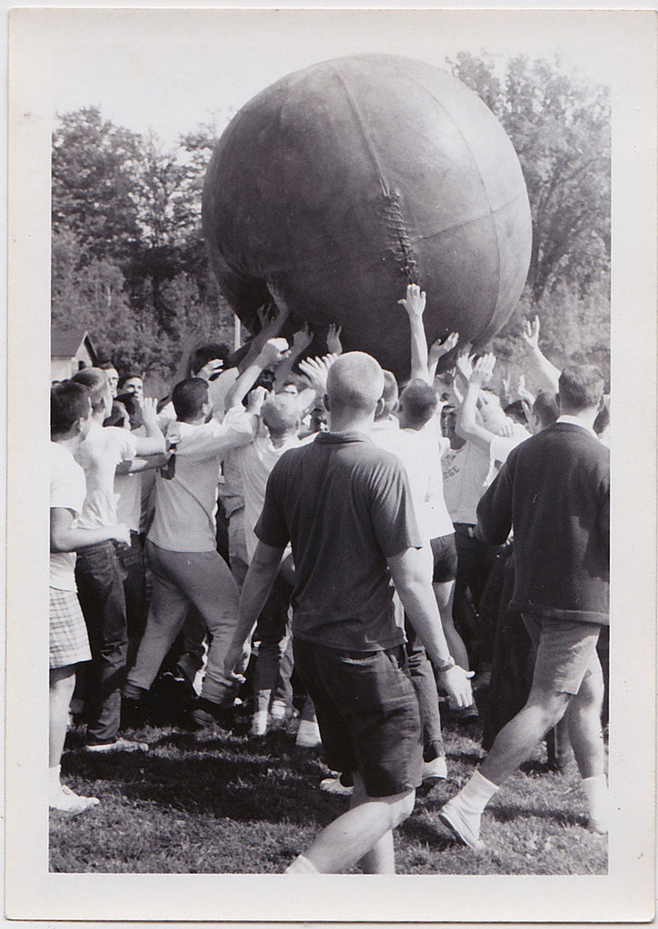 Men Pushing a Giant Leather Ball vintage snapshot