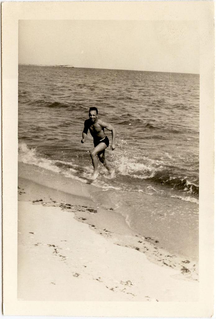 Man Running Out of Ocean vintage photo