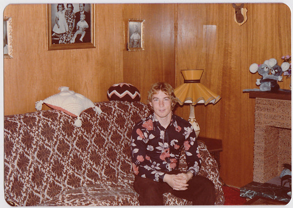 Handsome Guy on Sofa vintage color photo