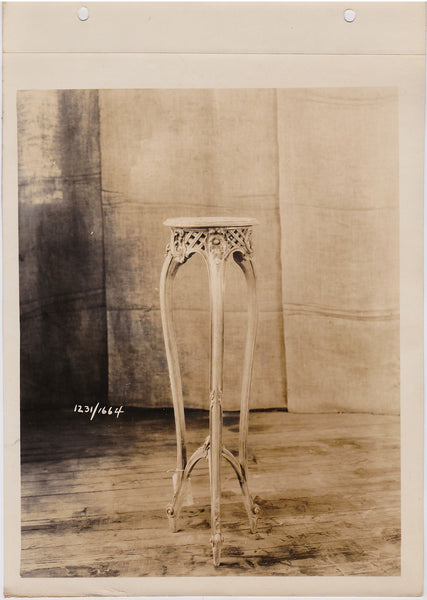 vintage sepia photo Elegant table/plant stand rests lightly on the wood floor, almost like a dancer en pointe.