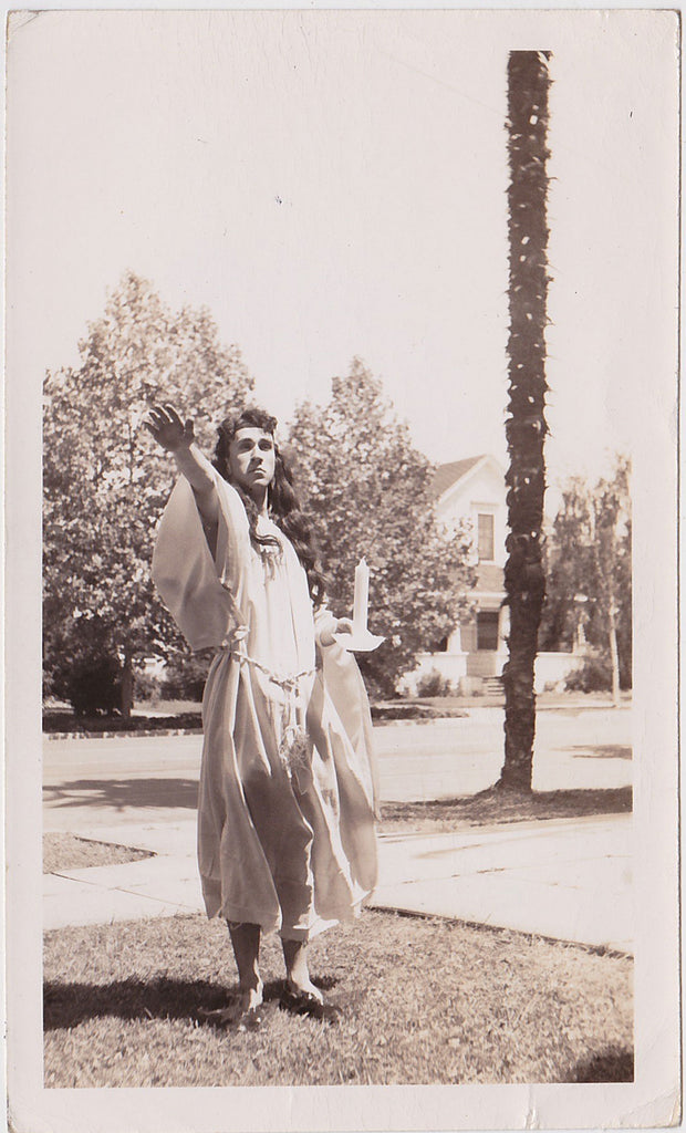 Man in Drag Holding Candle vintage sepia photo