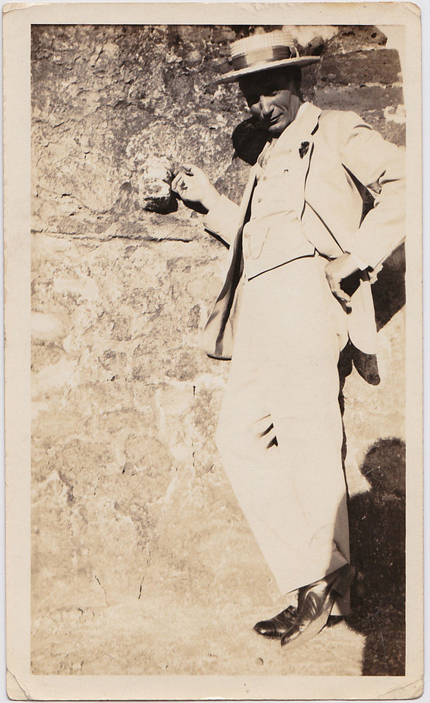 "Vintage Sepia Photo: Man Leaning Against ""The Abutment"" Mexico"