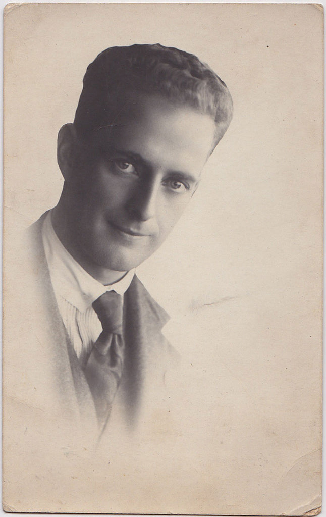 Handsome man with a kind expression, unusual composition. Australia c. 1923 Vintage real photo postcard