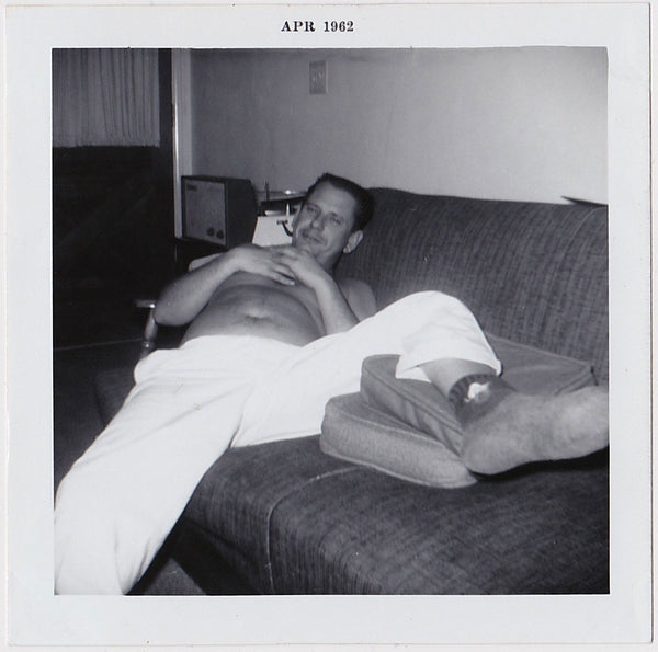 man resting on sofa vintage photo