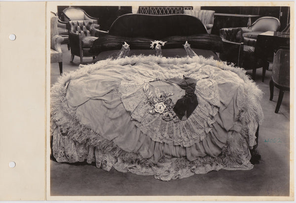 vintage photo It almost looks like an antebellum dress with marabou, lace, fabric roses and a giant velvet bow.