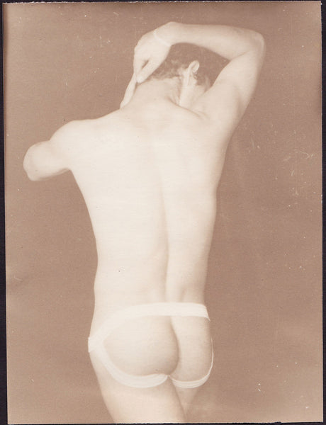 Man wearing jock strap, seen from behind, by Edward A. McAndrews.