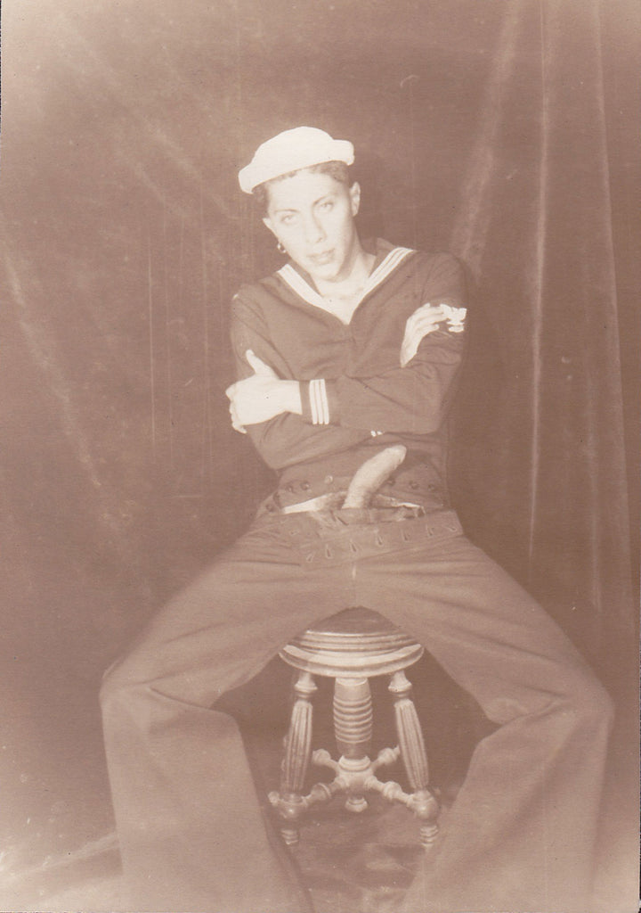 Sailor with erection seated on a stool, by Edward A. McAndrews vintage photo.
