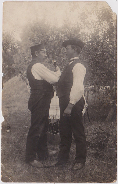Affectionate Men Toasting: Real Photo Postcard