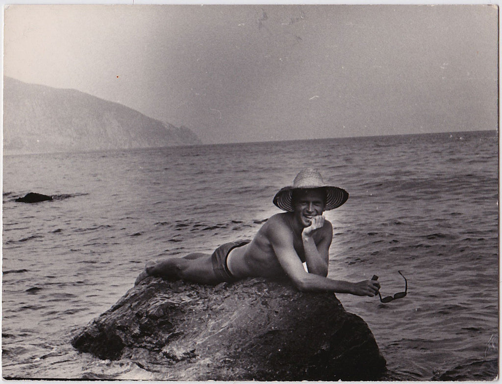 Handsome guy reclines on a rock like a merman.  Vintage photo gloss finish on heavyweight paper, undated 1960.