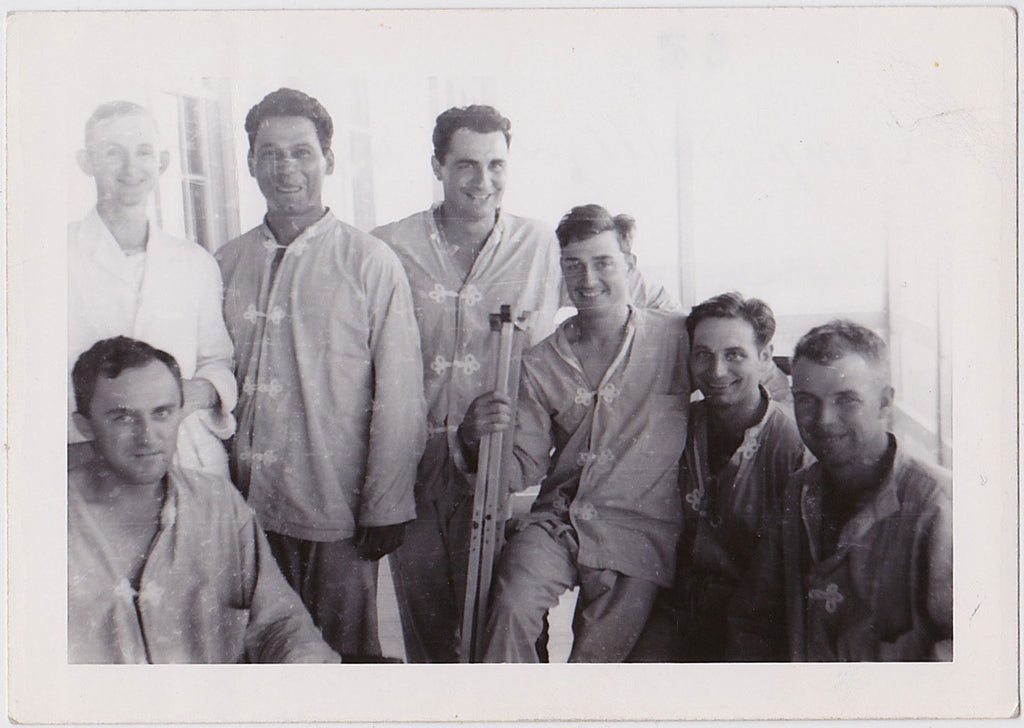 A group of seven smiling patients at Camp Swift, June 44 vintage snapshot