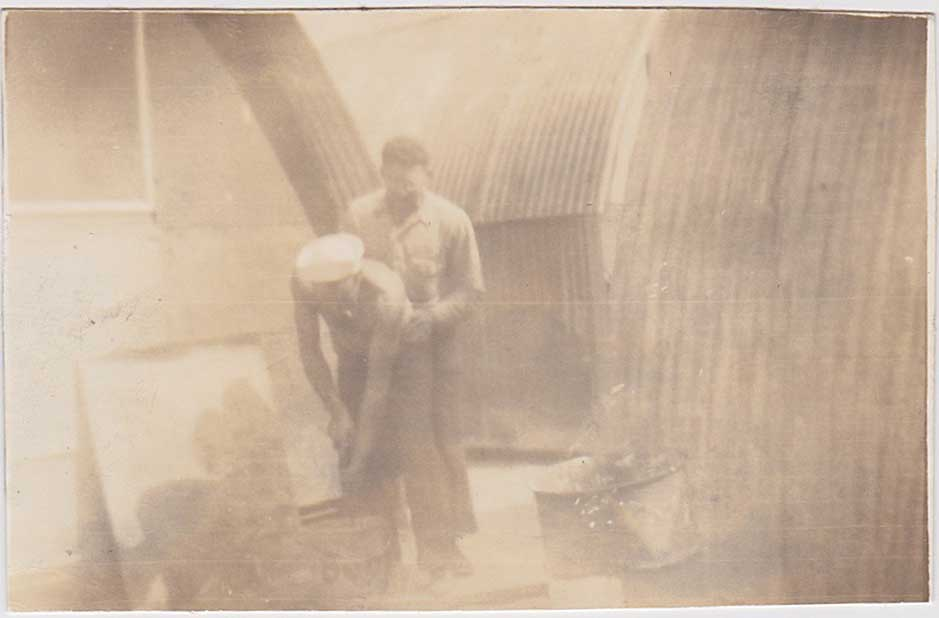 Intimate Moment Between Huts: Vintage Snapshot