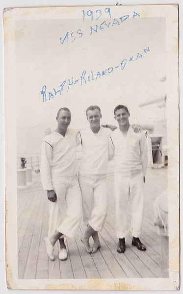 These affectionate sailors identified as Ralph, Roland and Dean, stand on the deck of the USS Nevada. Unusual assortment of footwear.