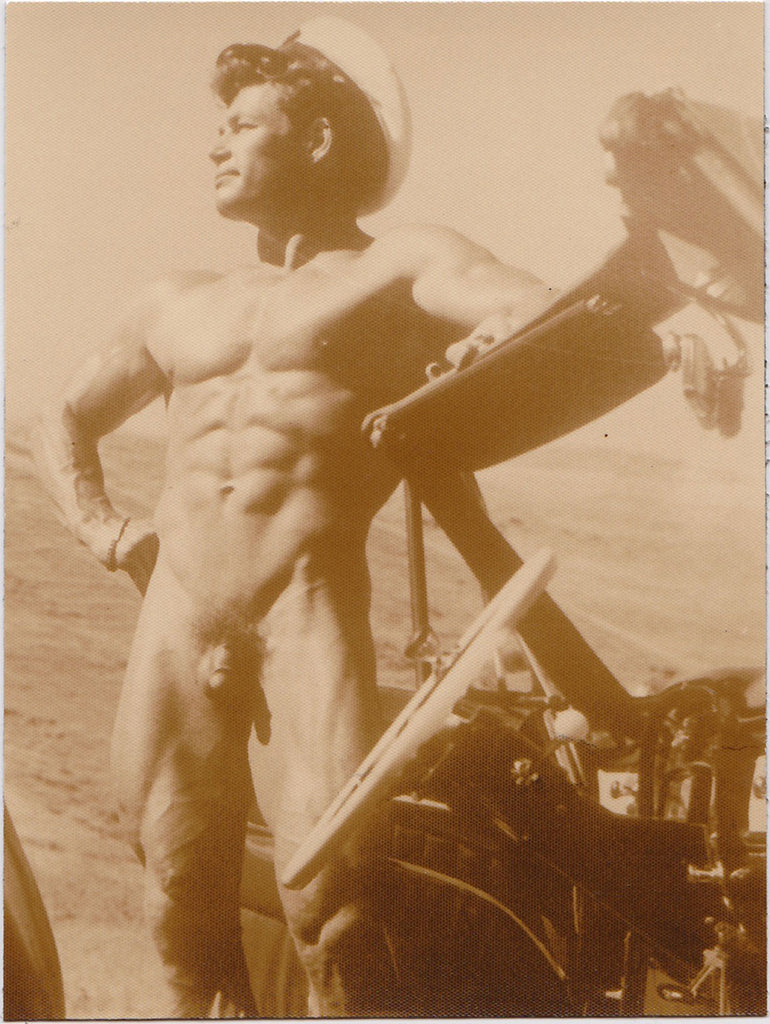 Vintage male nude photo South African bodybuilder Roy Hilligan posing by his convertible, by Russ Warner