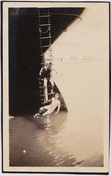 Two Men Dangling from Ship's Ladder: Vintage Snapshot