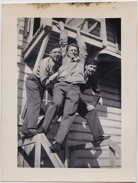 Vintage snapshot of three soldiers hanging around, smoking cigars, having fun.