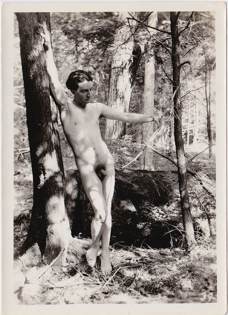Anonymous vintage male nude in forest