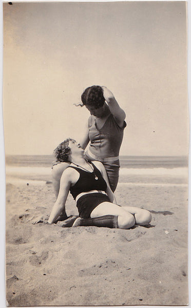 Two women strike a romantic pose on the beach vintage photo