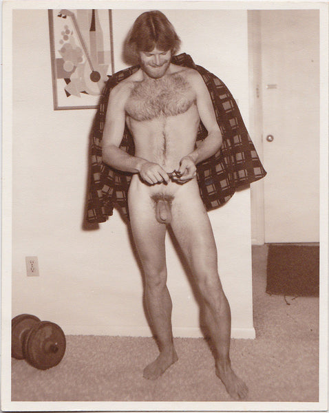 Vintage photo by Don Whitman / Western Photography Guild of a bearded hairy chested man with a flannel shirt miraculously floating behind him
