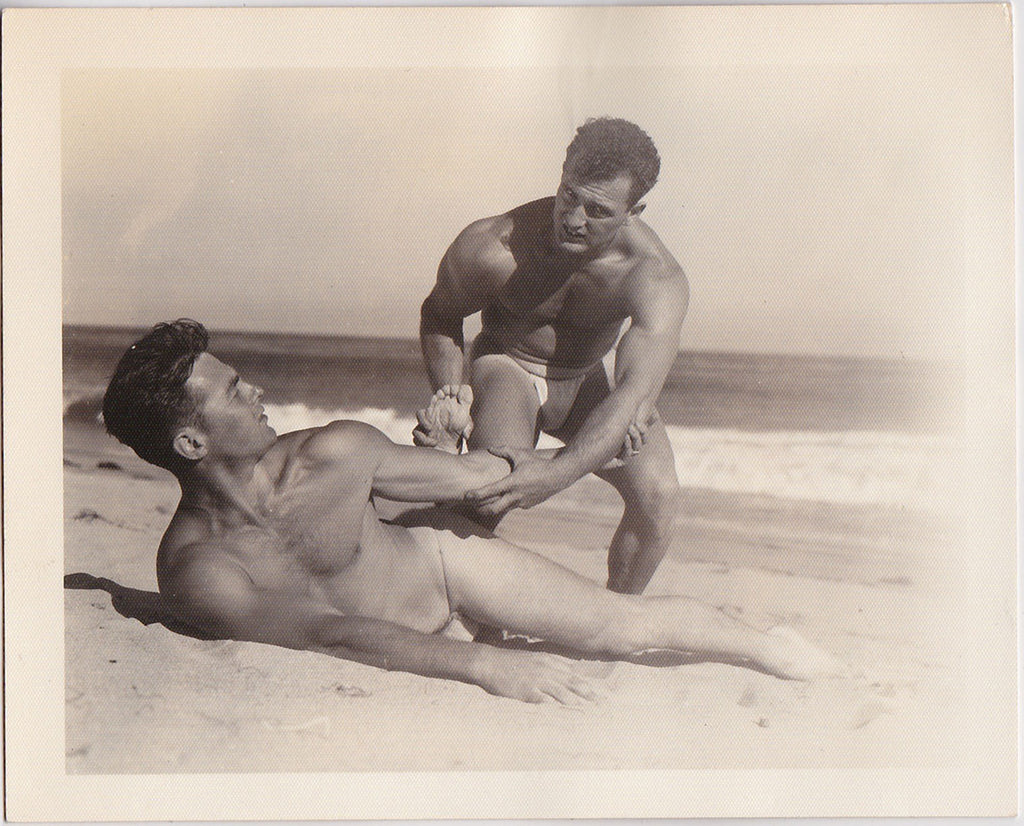 Muscular wrestlers on beach, vintage photo Bruce of LA
